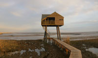 Bird hide Kiekkaaste in Nieuwe Statenzijl during low tide -73 NAP